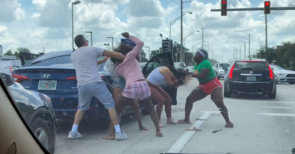 People fighting with road rage at a stoplight in Tampa.