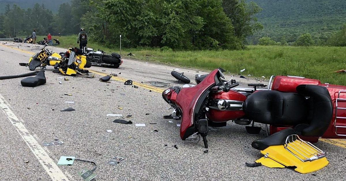Two motorcycles collided and lay damaged on the road