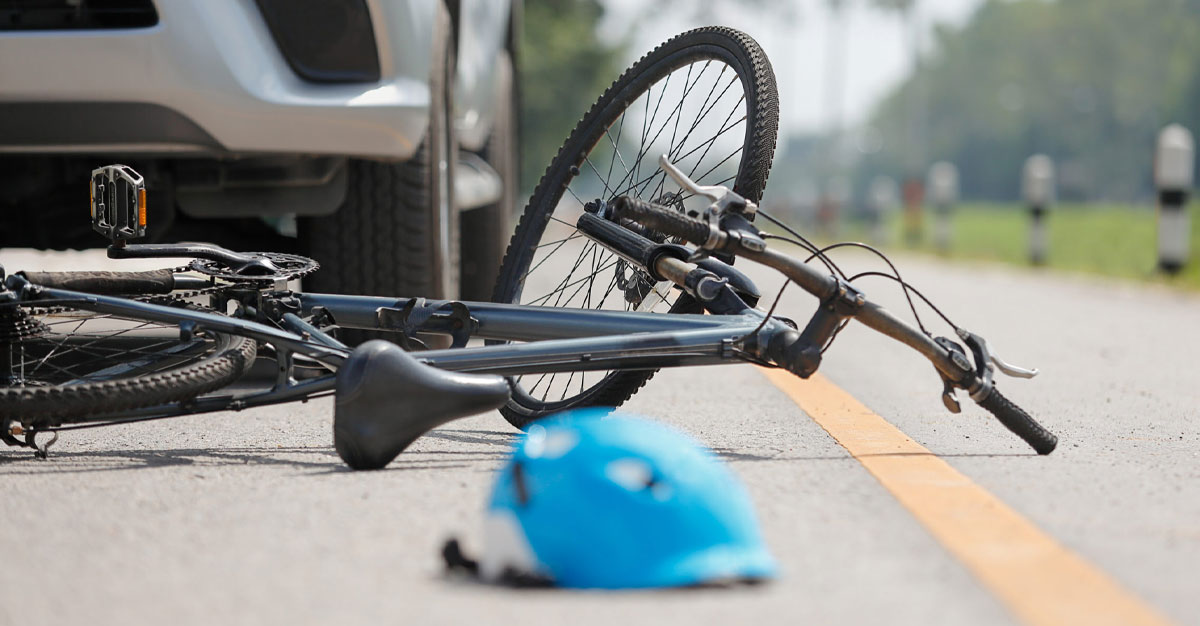 Bicycle and helmet laying in the street after an accident