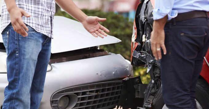Two men arguing after a car accident