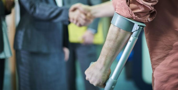 Injured man shakes hands with attorney